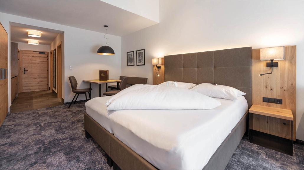Doppelbett in Ferienwohnung Apart Peppone